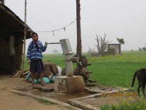 Girl pumping water